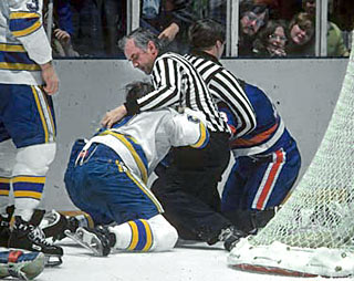 On October 16, 1973, Neil Arrmstrong was honoured for breaking the record for game officiated by an NHL official (1,314 games) previously held by George Hayes.