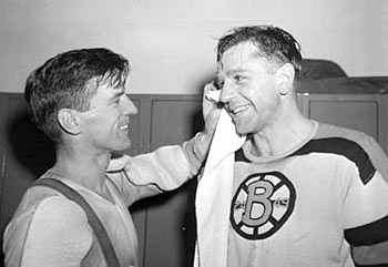 Frank Brimsek and Woody Dumart of the Boston Bruins sharing a laugh.