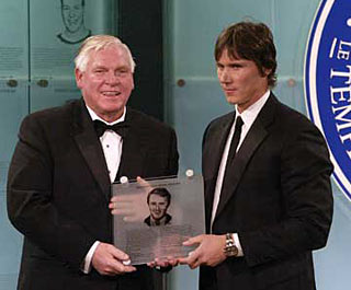 Dan Brooks, son of the late Herb Brooks accpets his fathers honoured members plaque from Hockey Hall of Fame Chairman and CEO, Bill Hay after being inducted posthumously into the Hockey Hall of Fame in 2006.