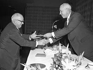 Clarence Campbell presents Jack Adams with his Honoured Members plaque after being inducted in 1959.