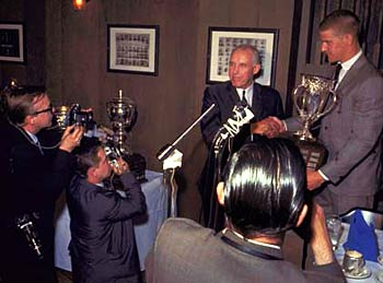 Clarence Campbell presenting the Calder Memorial Trophy to Boston Bruin Bobby Orr in 1967.