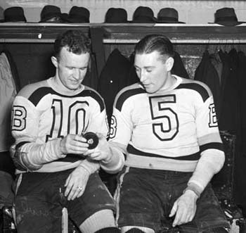 Bill Cowley #10 and Dit Clapper #5 of the Boston Bruins.