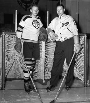 Dit Clapper and one of his players at a Boston Bruins' practice.