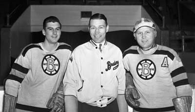 Dit Clapper along with two of his Boston Bruins players.