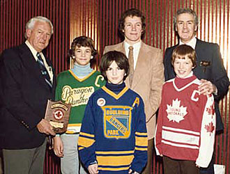 Murray Costello is recognized for making significant contributions to the merging of Hockey Canada and the Canadian Hockey Association.