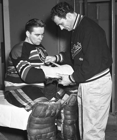 Emile Francis and a Chicago Blackhawks trainer prior to a game