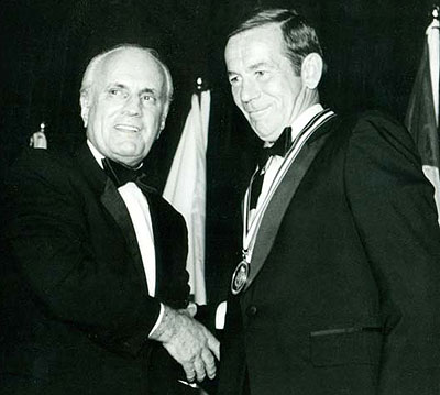 Tommy Ivan presents Emile Francis with his Hockey Hall of Fame induction medal in 1982