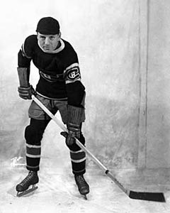 Aurele Joliat wearing his trademark black cap while as a member of the Montreal Canadiens.