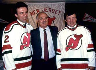 Lou Lamoriello along with newest members of the New Jersey Devils Viacheslav Festisov and Sergei Starikov