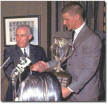 Bobby Orr accepting the Calder Trophy from NHL president Clarence Campbell in 1967.