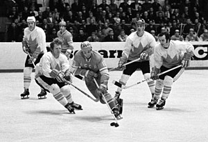 Alexander Maltsev of the Soviet Union skates with the puck while Canada's Pat Stapleton defends during 1972 Summit Series game action at Luzhniki Ice Palace in Moscow.