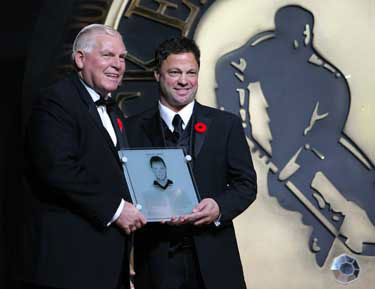Hockey Hall of Fame Chairman and CEO Bill Hay presents 2010 Inductee Dino Ciccarelli with his Honoured Members plaque