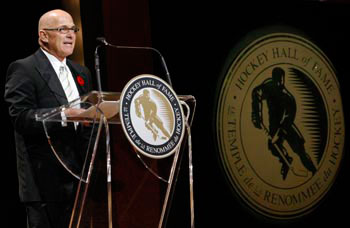 Ray Scapinello speaks during his induction into the Hockey Hall of Fame in 2008