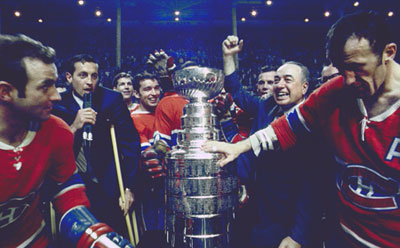 Hector 'Toe' Blake and the Montreal Canadiens celebrating a Stanley Cup title in 1968.