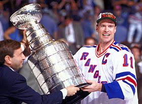 NHL Commissioner Gary Bettman presents the Stanley Cup to New York Ranger  captain Mark Messier following the Rangers 4 games to 3 series win over the  ... 90c7c61f4